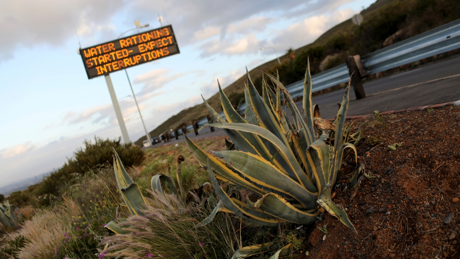 Sign warning residents of water restrictions is seen in Cape Town.