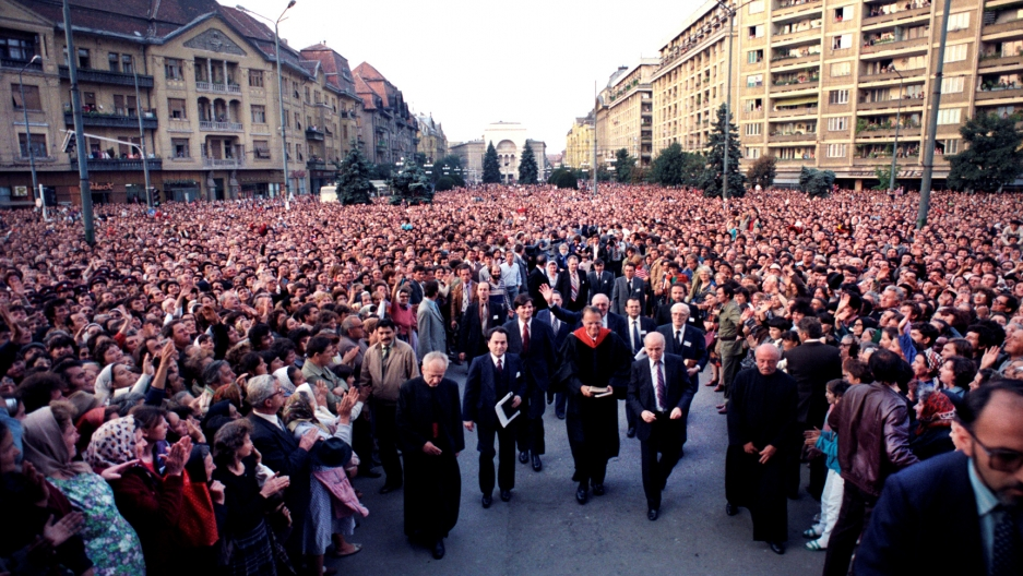 The Rev. Billy Graham, accompanied by his son Franklin, went on a seven-city trip to Romania in 1985 that was marked by crowds in excess of 100,000 at times.