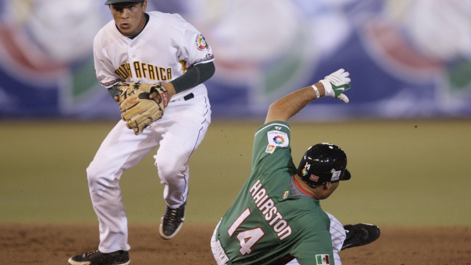 Mexico's Scott Hairston (14) is out at second base as South Africa's Anthony Phillips throws to first base during the first inning of their World Baseball Classic game in Mexico City March 9, 2009.