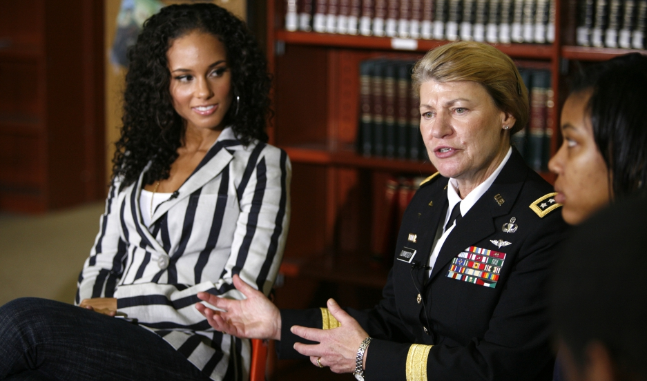 Gen. Ann Dunwoody, then commanding general of US Army Material Command, speaks as singer Alicia Keys looks on during a roundtable discussion with students at Dunbar High School in Washington, DC, on March 19, 2009.
