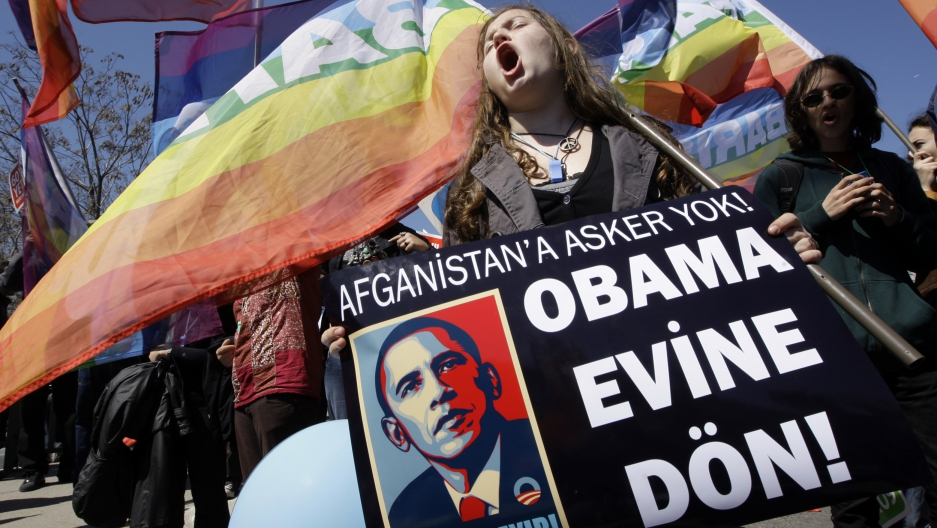 "A Turkish demonstrator holds a banner in Istanbul in April 2009. It reads, ""No soldiers for Afghanistan. Return to your home Obama."""