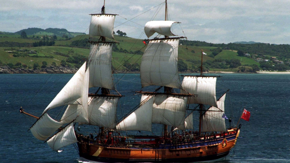 A replica of Captain Cook's ship, the Endeavour, sailing off the coast of New Zealand in 1995. The replica was built in Australia in 1994, where Cook is a national hero.
