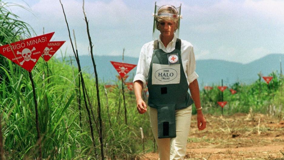 Princess Diana walks through a minefield in Angola, 1997