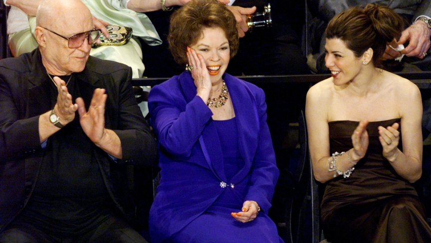 Former actress and diplomat Shirley Temple Black reacts to being introduced as she sits with Rod Steiger and Marisa Tomei during the 70th annual Academy Awards March 23. Seventy former Oscar winners gathered on stage during the show. Temple Black won her