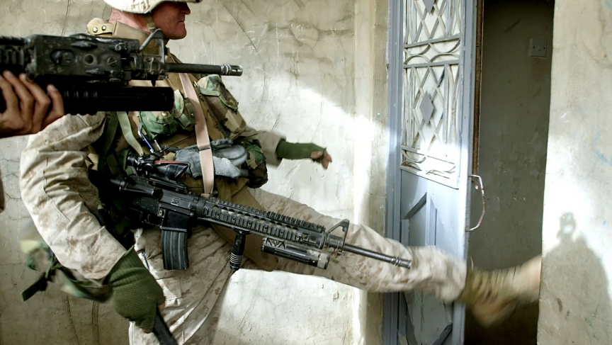 "U.S. Marine Lance Corporal Michael Oliver Ray, on a search operation in Fallujah, Iraq in December 2004. An American offensive at the time came to be known as ""The Second Battle of Fallujah."""