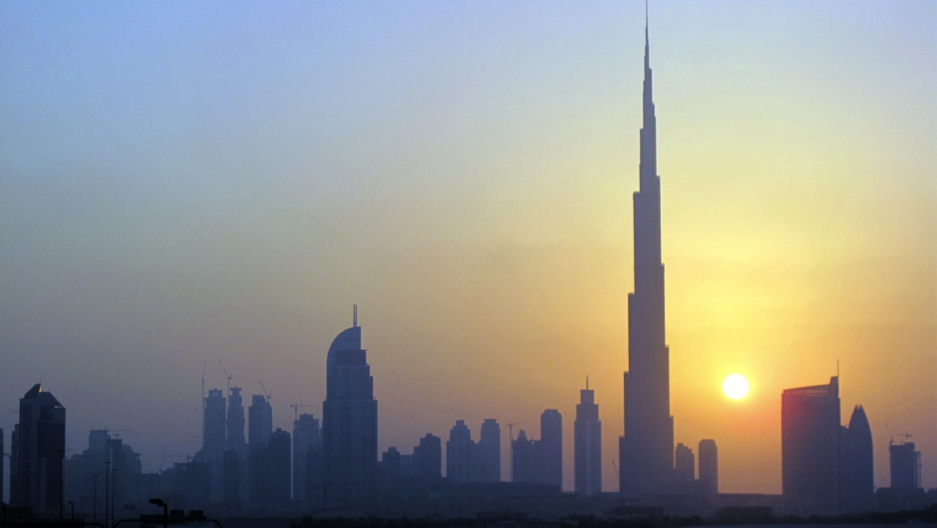 The Burj Khalifa (C) skyscraper is seen as the sun sets over Dubai on Oct. 5, 2010.