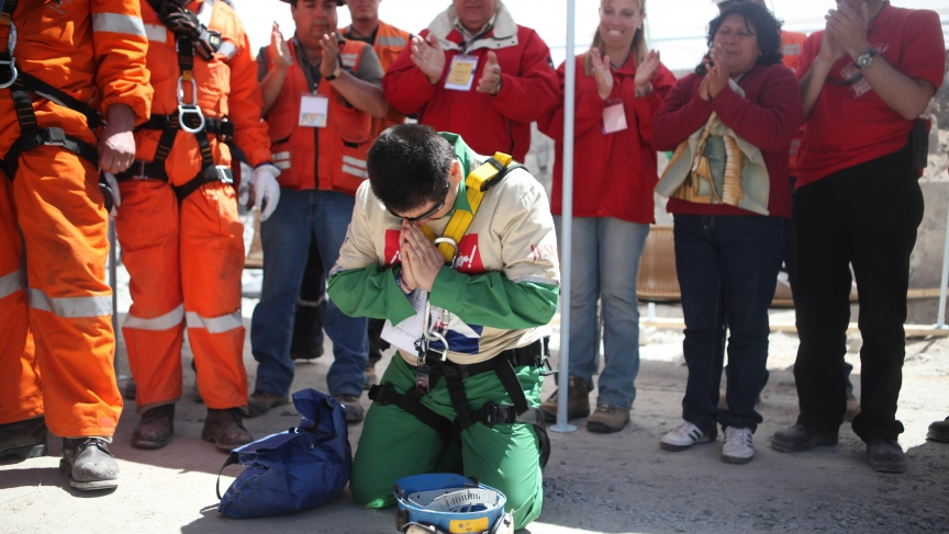 Trapped miner, Esteban Rojas, kneels to pray after being rescued from the San Jose mine in Copiapo, October 13th, 2010.