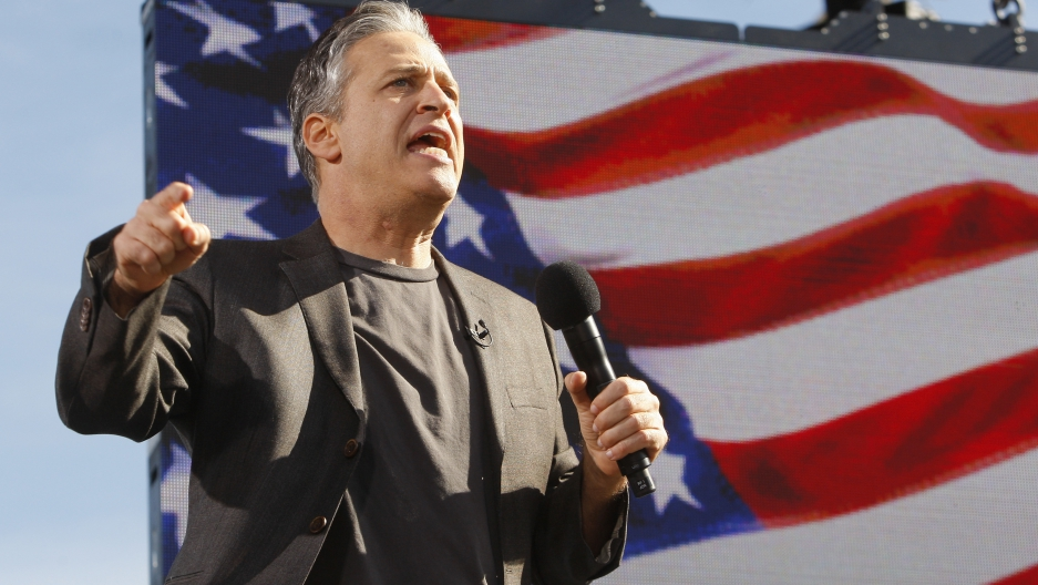 "Comedian Jon Stewart addresses the crowd during the ""Rally to Restore Sanity and/or Fear"" in Washington, October 30, 2010."