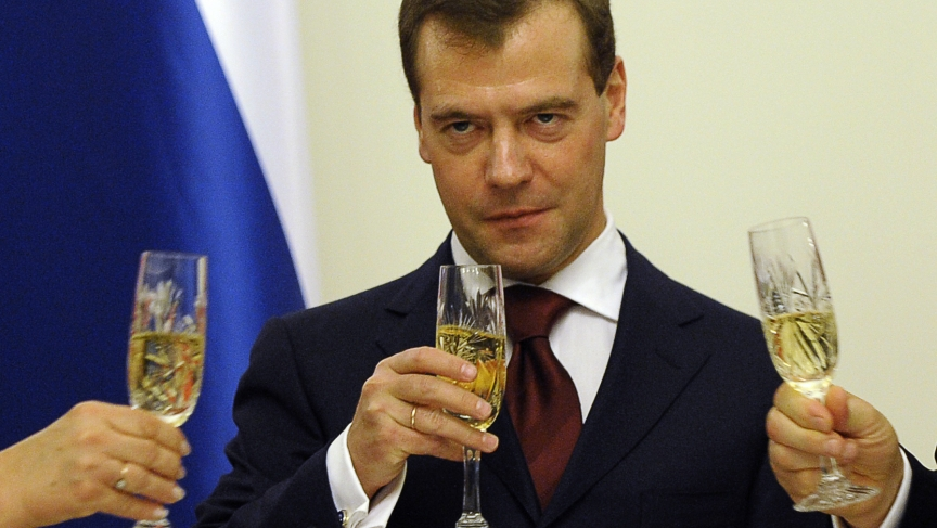 Then-President Dmitry Medvedev of Russia toasts with champagne during a state dinner in Warsaw in 2010.