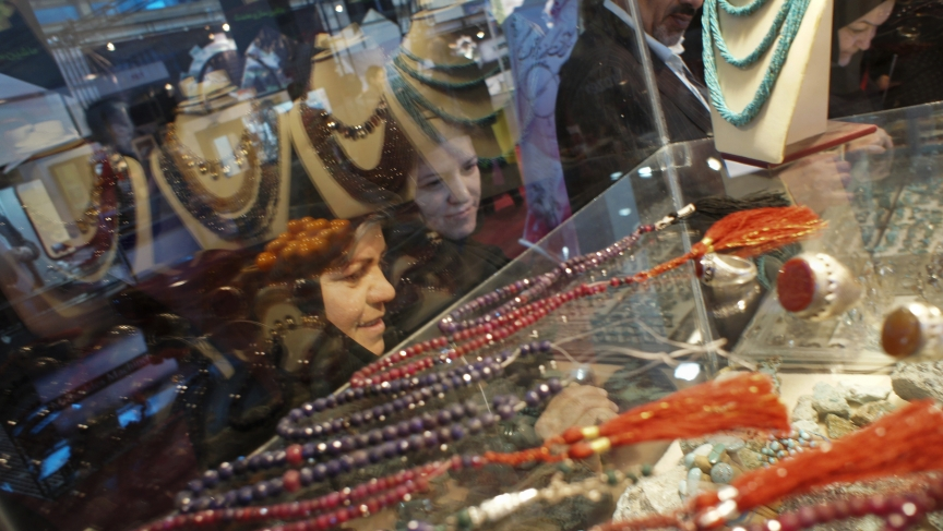 Women gaze at jewelery displayed at an international fair in Tehran.