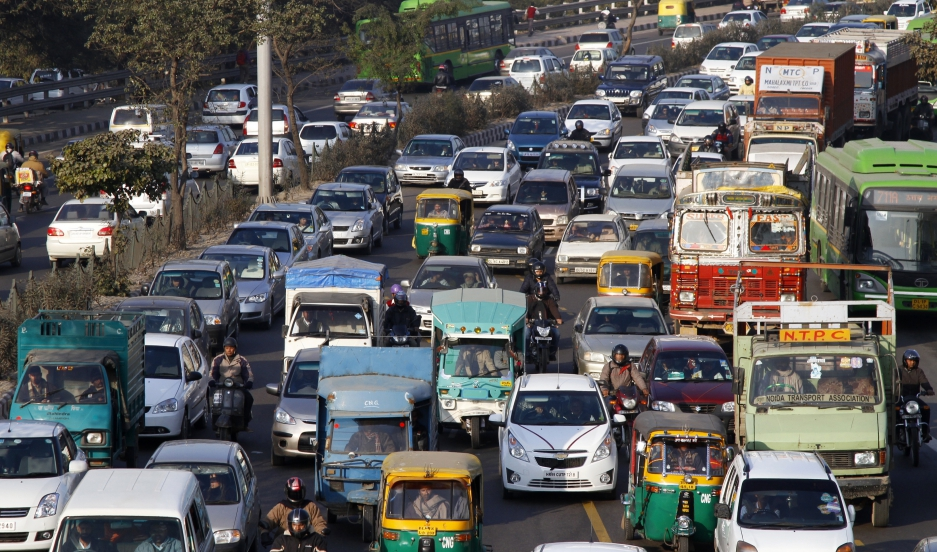 Heavy traffic along a busy road in New Delhi