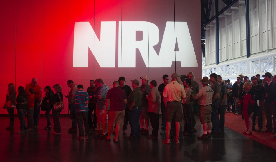 Attendees line up to meet musician Ted Nugent at a book signing event during the National Rifle Association's annual meeting in Houston, Texas, on May 5, 2013.