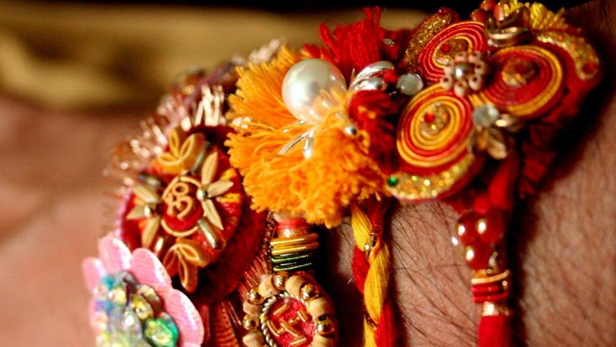 "Rakhia are ""sacred threads"" that sisters tie onto their brothers' wrists for the Hindu festival of Raksha Bandhan."