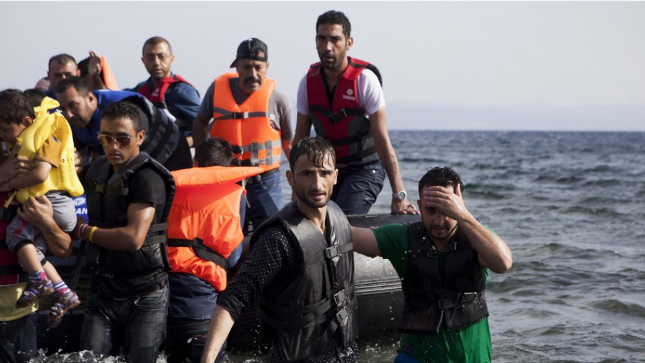 Syrian refugees arrive on a dinghy on the Greek island of Lesbos
