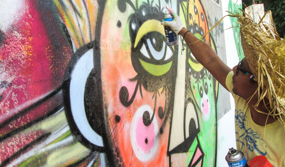 Graffiti artist Rei Blinky at work in San Pedro Sula, Honduras.