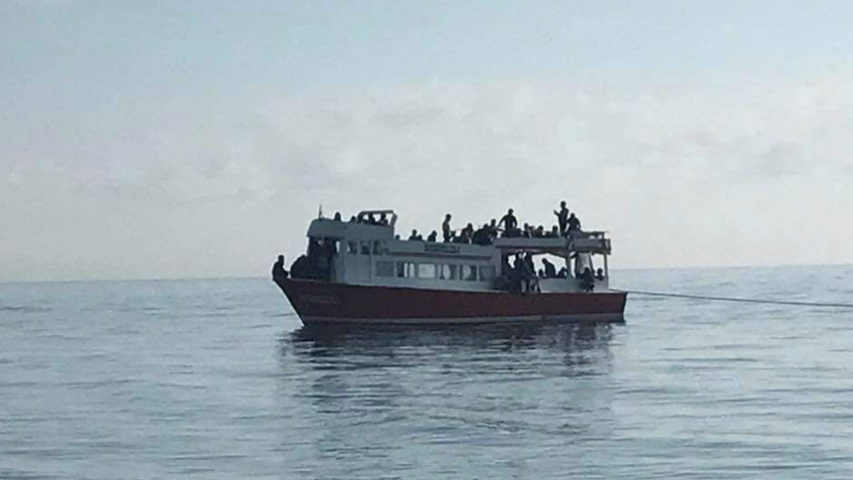 A migrant ship on the Black Sea is rescued by the Romanian coast guard.