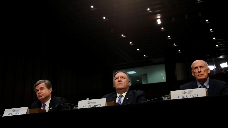 "FBI Director Christopher Wray, CIA Director Mike Pompeo and Director of National Intelligence Dan Coats testify before a Senate Intelligence Committee hearing on ""World Wide Threats"" in Washington, Feb. 13, 2018."
