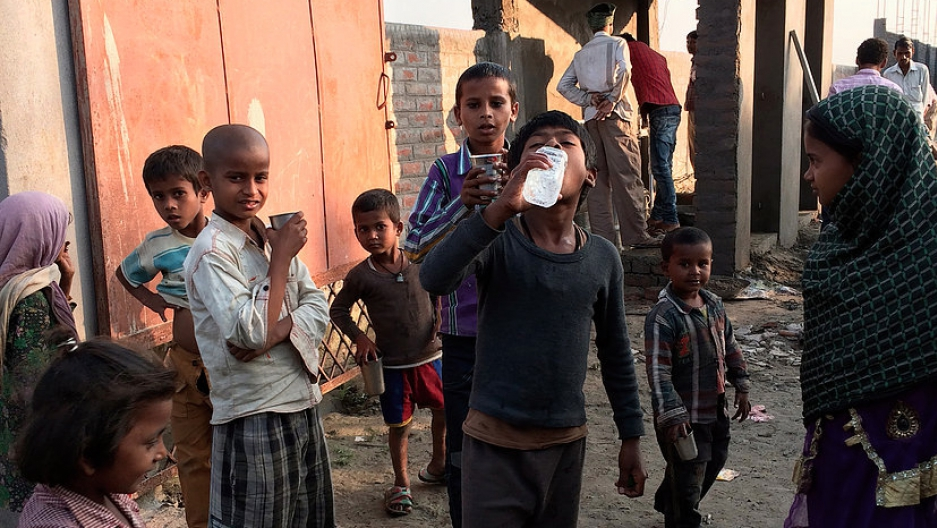 Children drink water from the SHRI sanitation system.