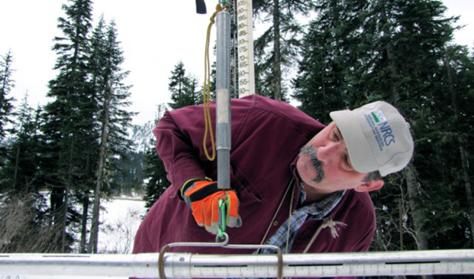 Scott Pattee, a water supply specialist with the National Resources Conservation Service, checks snow levels at Stevens Pass ski resort in Washington's Cascade Mountains.