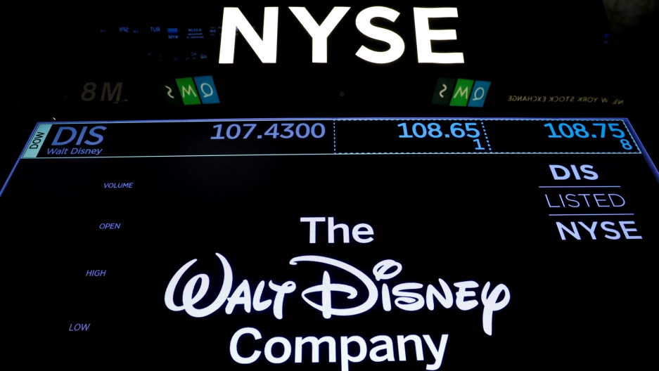 A screen shows the trading info for The Walt Disney Co. on the floor of the New York Stock Exchange (NYSE) in New York.