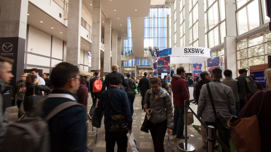 Attendees of SXSW Interactive pass through the halls inside the Austin Convention Center.