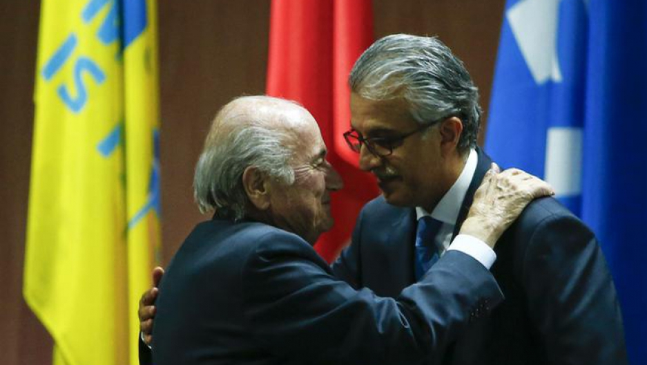 Executive Committee member Salman Bin Ebrahim Al Khalifa (R) congratulates FIFA President Sepp Blatter after he was re-elected at the FIFA Congress in Zurich, Switzerland, May 29, 2015.