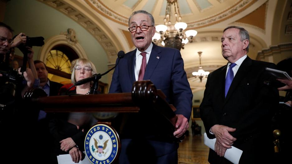 Senate Minority Leader Chuck Schumer, accompanied by Sen. Dick Durbin and Sen. Patty Murray, speaks with reporters in Washington, Jan. 23, 2018.