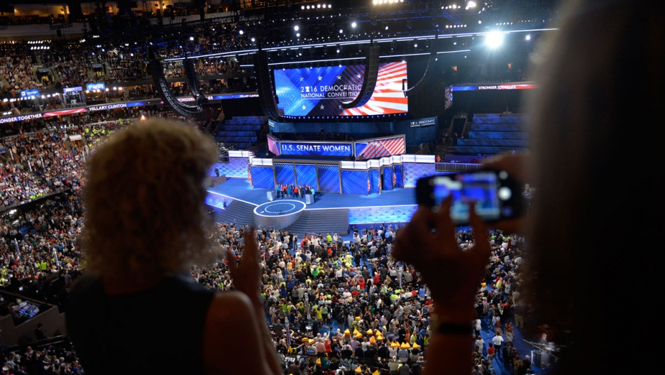 Delegates watch the Democratic Women of the Senate address at the DNC in Philadelphia.