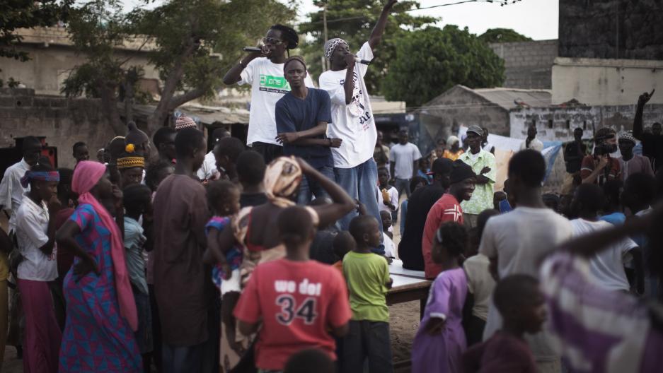 Members of the hip-hop group Y'en a marre perform during a community concert in the Dalifort neighbourhood of Senegal's capital Dakar, June 18, 2011.