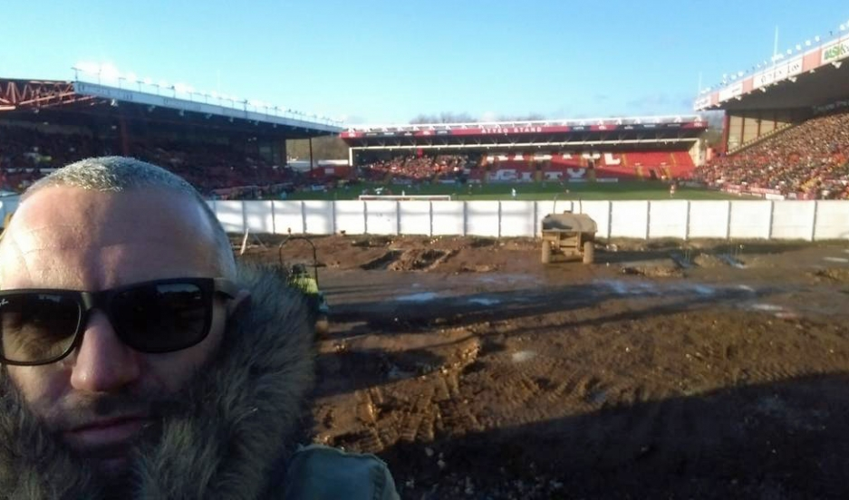 Ben Swift, commonly known as East End Shedman, poses from his viewing spot at the east end of Bristol's Ashton Gate stadium.