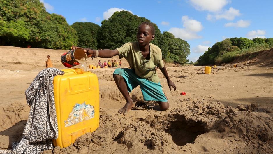 Somali boy gathering water