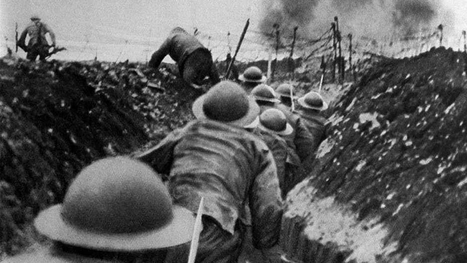 Soldiers begin leaving a trench during the battle of the Somme, 1916