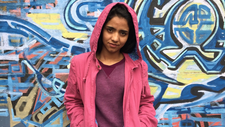 Afghan rapper Sonita Alizadeh narrowly escaped a forced marriage at 16 by writing the song 'Brides for Sale.' She recently visited West Oakland, CA, and was surprised that the U.S., like Iran and Afghanistan, has poor neighborhoods and homeless people.