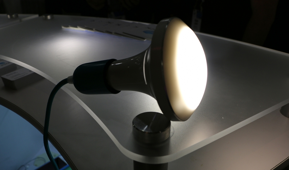 "This new ceiling lamp from Stack Lighting is on a growing list of household products that are ""smart,"" but also green. It uses sensors to adjust itself based on ambient lighting in a room, and switch itself off if there's no one there. The company says th"