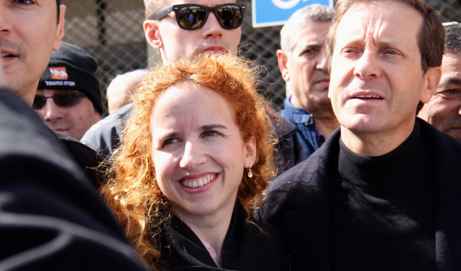 Firebrand Israeli politician Stav Shaffir stands with Yitzhak Herzog, the chairman of Israel's Labor Party and fellow member of the Israeli parliament.