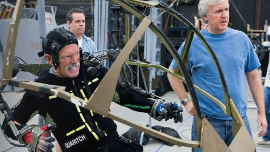 "Actor Stephen Lang performing in an ""amp suit,"" with director James Cameron by his side"