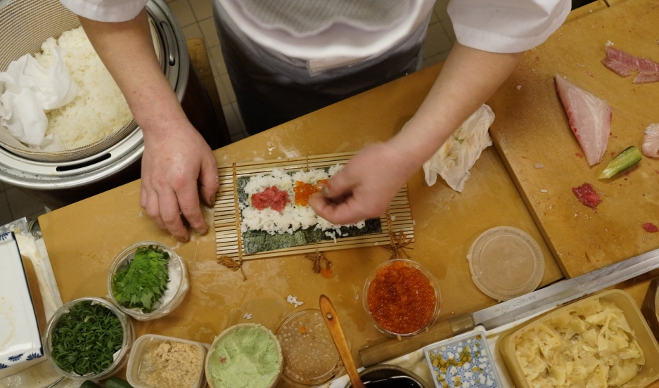 Chef Susumu Yajima carefully forms a delicious roll of sushi