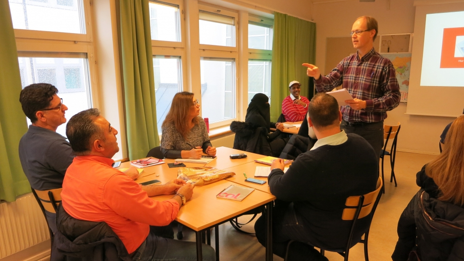Arne Fredriksson instructs students from the Middle East and Africa in Swedish language, SFI-Södertälje.