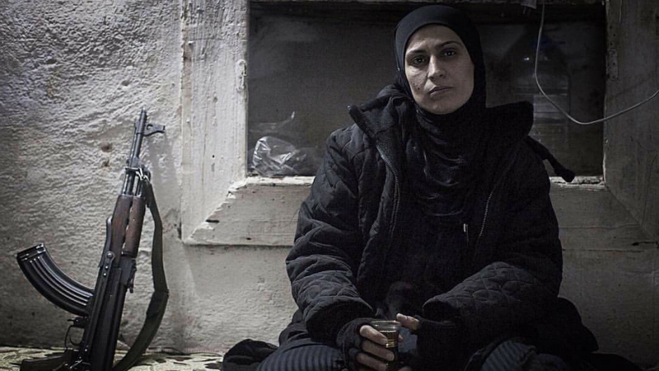 A part-time fighter with the anti-government forces in Aleppo, who gave her name simply as 'Um Abdo' - or 'mother of Abdo,' her eldest son