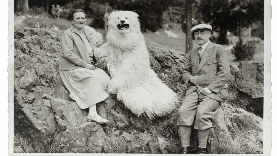 """A couple pose on a rock with a """"polar bear"""" somewhere in Germany"""