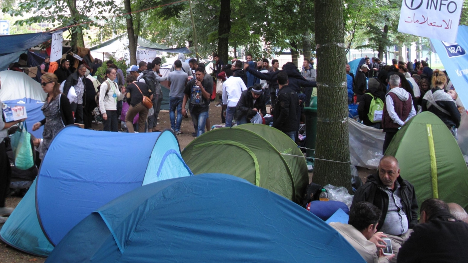 A public park in downtown Brussels houses a tent city with scores of families camping out in donated tents. Charity workers say they've never seen so many refugees occupy a public space at one time in Belgium.