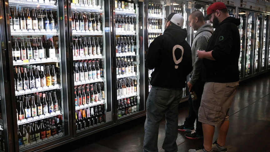 Beer buyers contemplate their choices at The Beer Stein in Eugene, Oregon. Many of those choices are brewed by Oregon's 171 craft breweries.