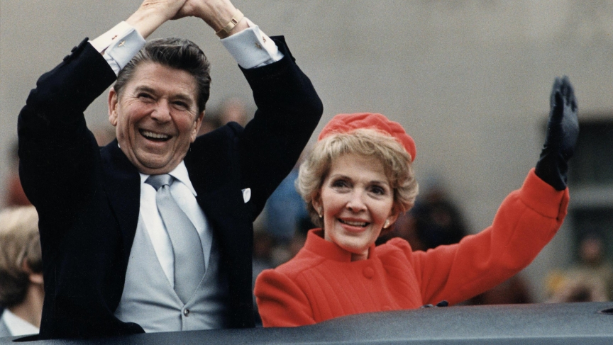 Ronald Reagan and his wife, Nancy, wave to crowds from their limousine during Reagan's first inauguration parade in 1981.