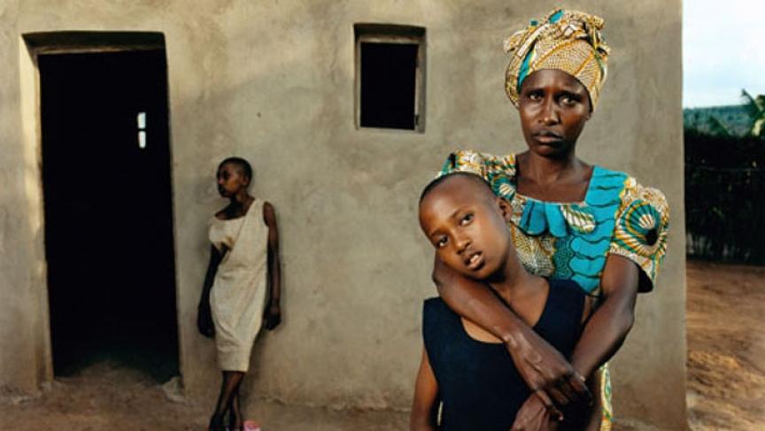 A genocide survivor and her children.