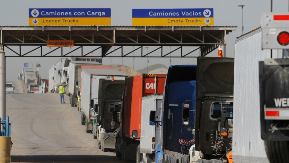 Trucks wait in a long queue for border customs control to cross into the U.S. at the Otay border crossing in Tijuana, Mexico, February 2, 2017.