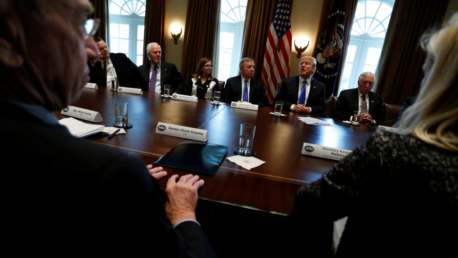 Lawmakers sitting around Trump during an immigration roundtable.