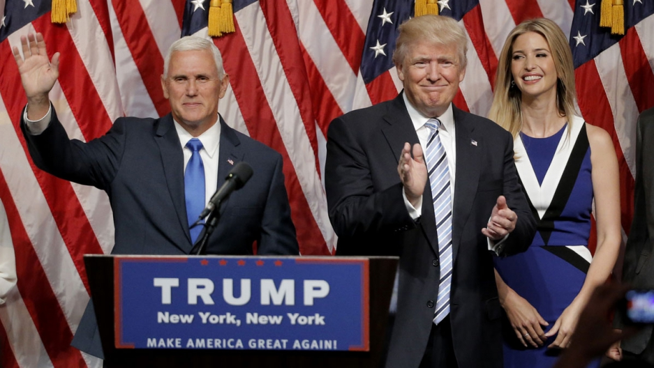 Republican presidential candidate Donald Trump applauds Saturday after introducing Indiana Governor Mike Pence as his vice presidential running mate.
