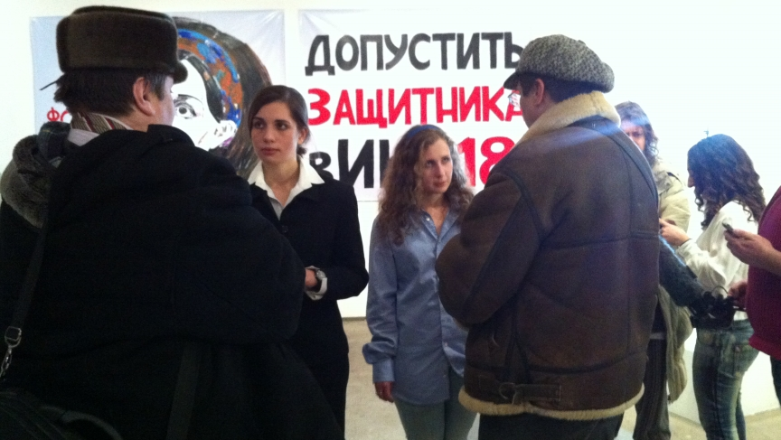 Pussy Riot's Nadezhda Tolokonnikova and Maria Aliokhina speak with two supporters at the Vinzavod Center for Contemporary Art in Moscow. Many wanted to speak with them about prison conditions in Russia.