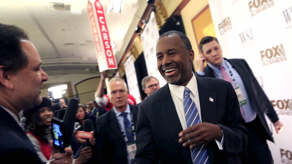 Ben Carson takes questions from the media in the spin room after the debate held by Fox Business Network for the top 2016 U.S. Republican candidates in Milwaukee, Wisconsin on November 10, 2015.