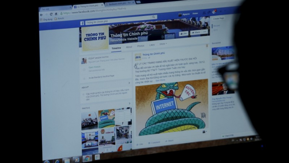 An internet user browses through the Vietnamese government's Facebook page in Hanoi.